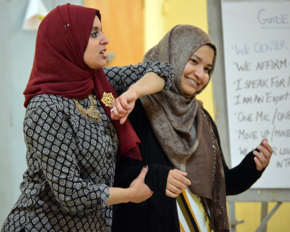 Rana Abdelhamid, left, demonstrates a tactic during a self-defense class in Washington, D.C. Her Women's Initiative for Self-Empowerment teaches young Muslim women martial arts and how to become leaders in their communities.