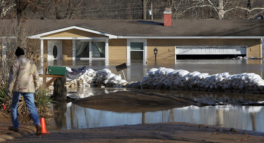 Sandbags failed to hold back water from this house, which stands flooded Friday in Arnold, Mo., as water from the Mississippi, Meremec and Missouri rivers was largely receding in the St. Louis area.