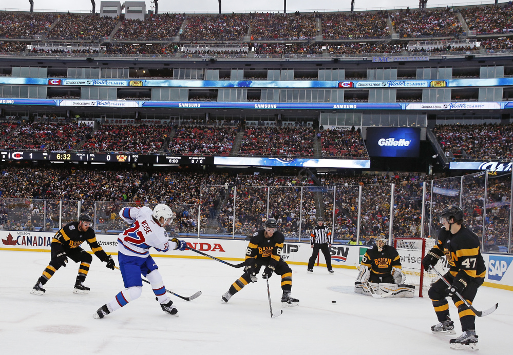 Canadiens right wing Dale Weise, left, takes a shot on Boston Bruins goalie Tuukka Rask during the first period of the Winter Classic Friday at Gillette Stadium in Foxborough, Mass.