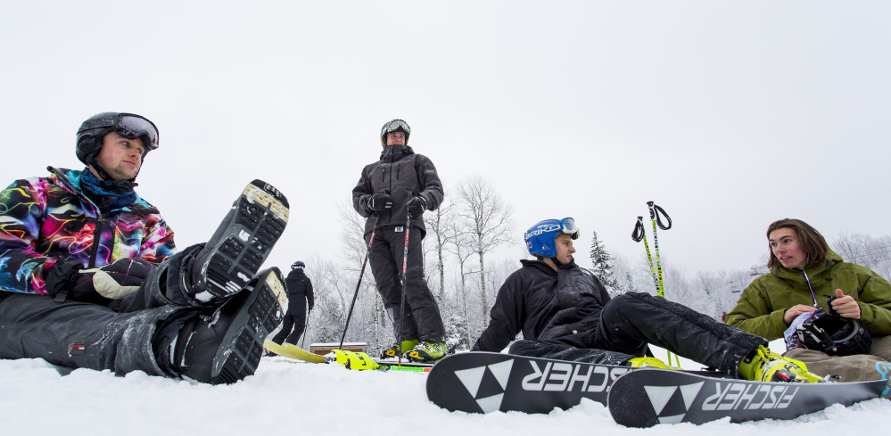 From left, Luke Wenzel, of Boston, Sean Daigle, Alex Daigle, and Toby Smith, all of Manchester, take a break at Sugarloaf. The group said that even though Saddleback Mountain is still closed this season, it hasn't affected them much since they hold passes to Sugarloaf.