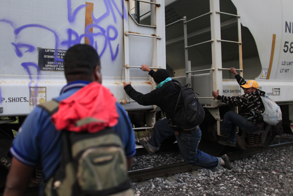 Honduran immigrants climb aboard a freight train heading toward the U.S. border in Orizaba, Mexico. Only those who meet the legal criteria should be granted asylum in the U.S. – having fled urban violence in Central America should not be enough to gain entry.