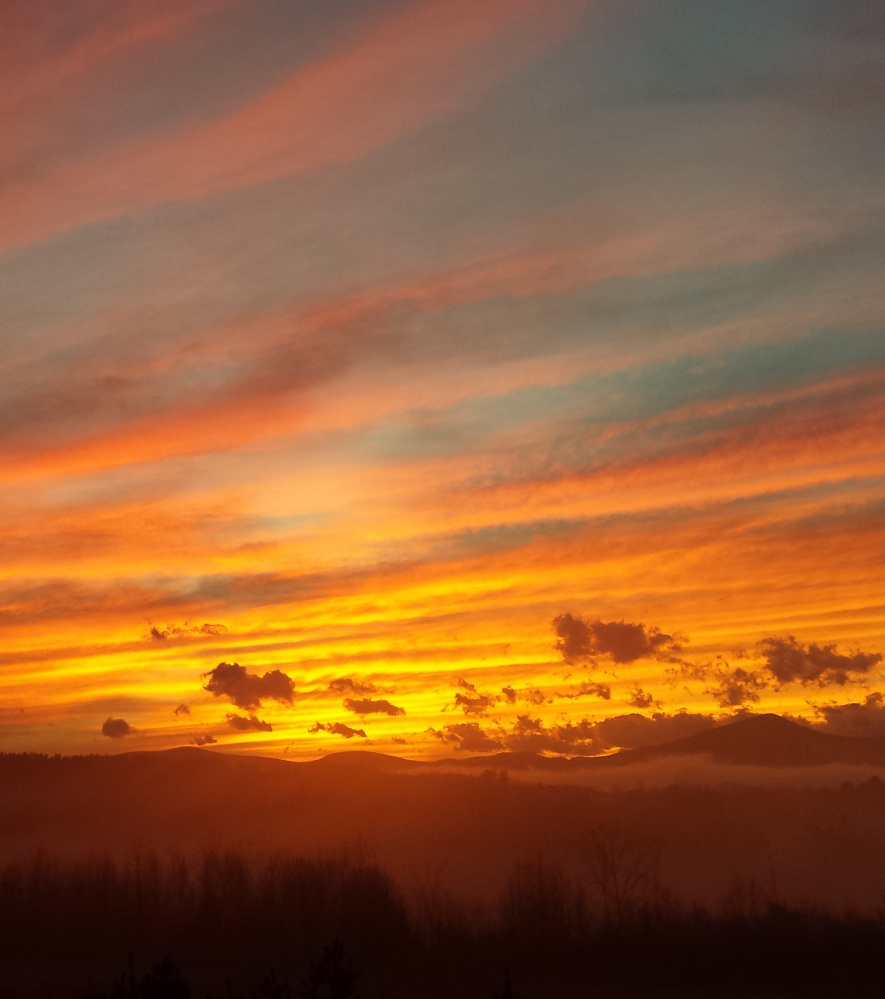 Clouds that hung over the White Mountains lifted just before sunset, when Mary Heroux of Center Lovell was there to witness the heavenly drama.