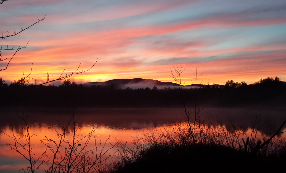 All was calm, all was bright as a Christmas Eve sunset turned the skies a dramatic hue over Mt. Misery and Ingalls Pond, where Colin Smith of Portland was able to capture it from Route 113 in Baldwin.