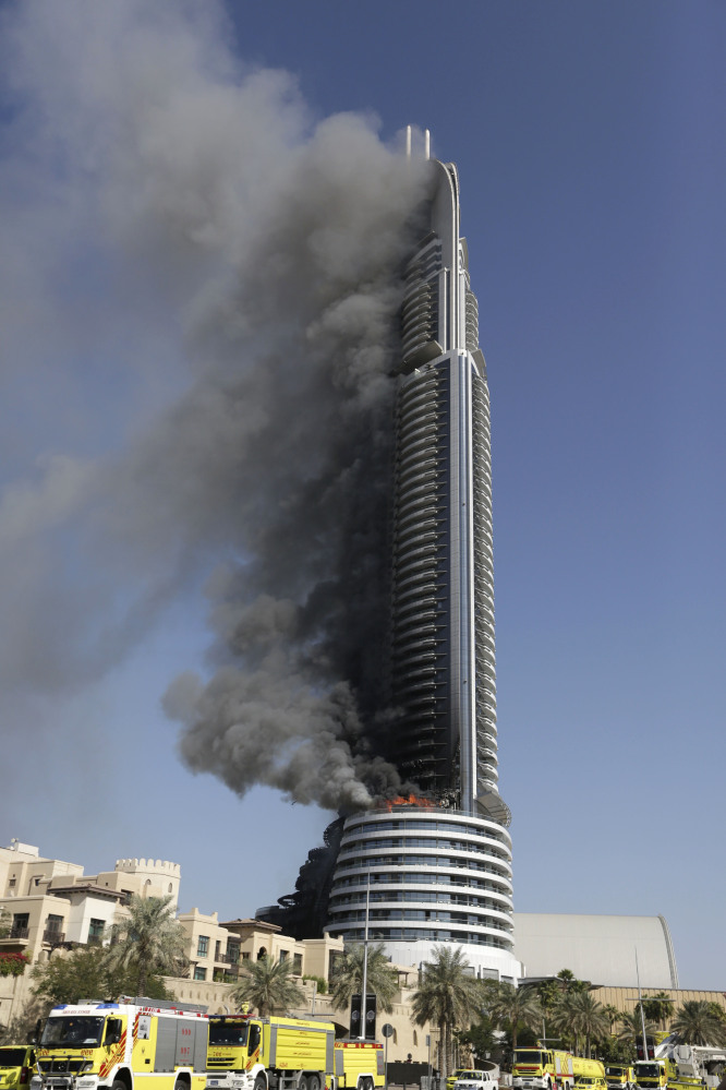 Smoke pours from a 63-floor skyscraper in Dubai, United Arab Emirates, on Friday. The blaze began Thursday night before Dubai's annual New Year's Eve fireworks show near the Burj Khalifa, the world's tallest building. which sits nearby.