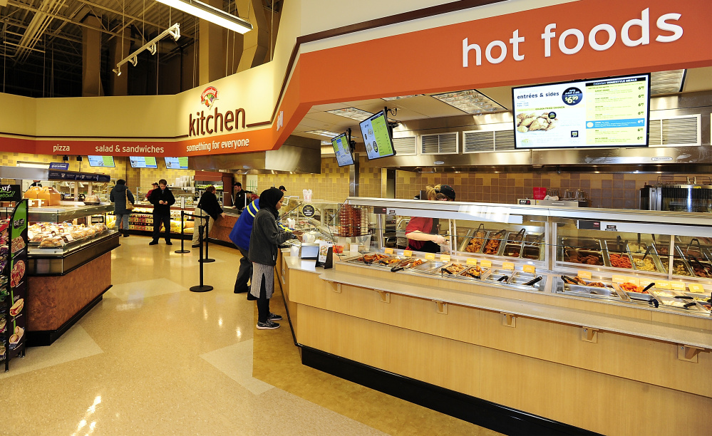 Customers select prepared food at the Forest Avenue Hannaford, where there's also a seating area and coffee bar. Gordon Chibroski/Staff Photographer