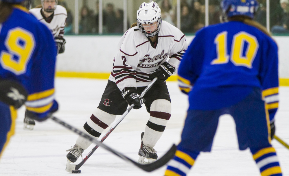 Greely senior Maura Verrill keeps the puck in the offensive zone Friday against Falmouth. Ben McCanna/Staff Photographer