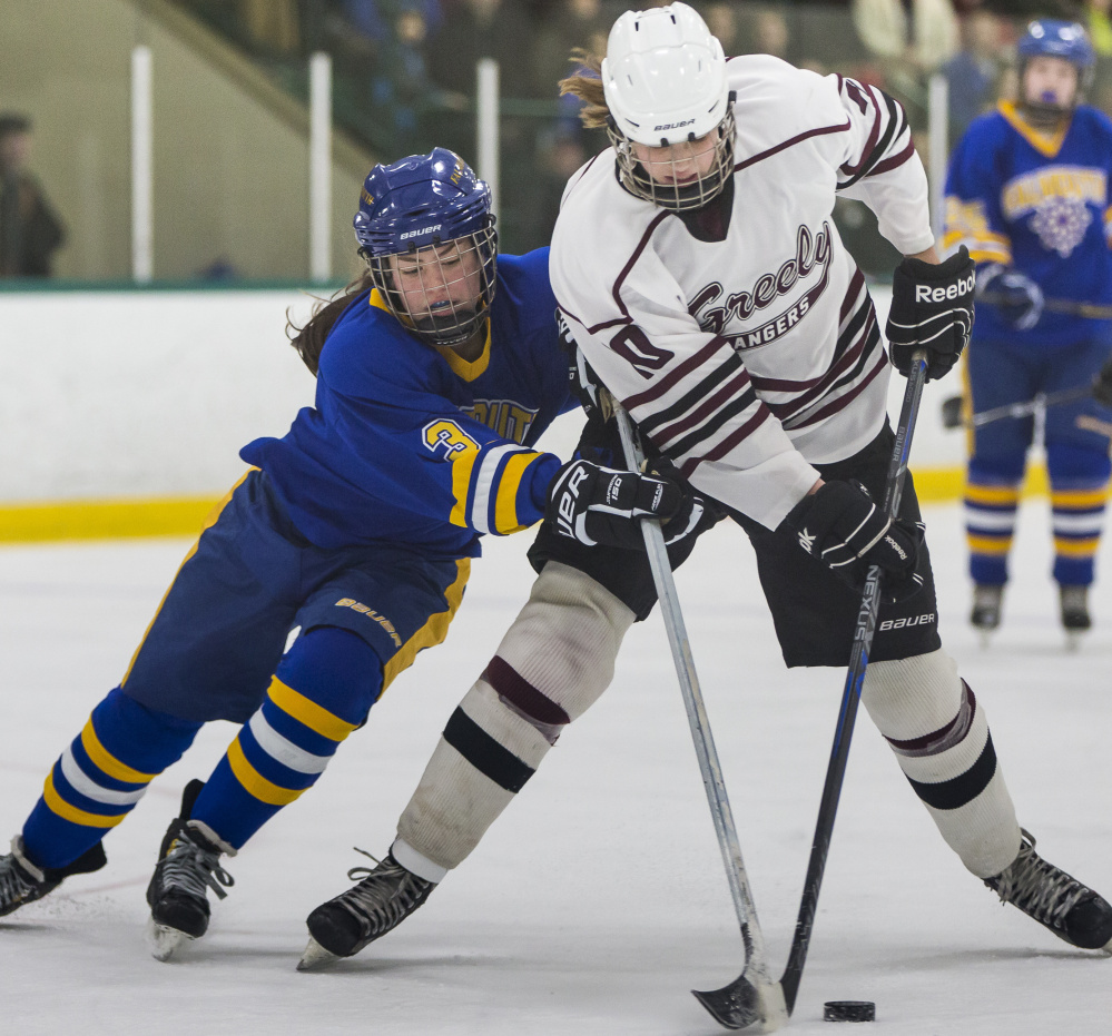 Falmouth's Kayla Sarazin, left, attempts to take the puck away from Greely's Courtney Sullivan during their game Friday at Family Ice Center. Greely won, 3-0.