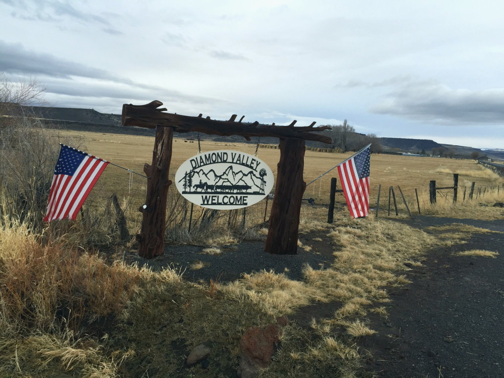 A sign welcomes visitors to the Diamond Valley, part of the Harney Basin in southeast Oregon, in mid-December. The valley is home to large cattle ranches that rely on both private and public land for grazing. The prosecution of Dwight and Steven Hammond for burning public lands has brought fresh focus to the debate over how federal land is managed.