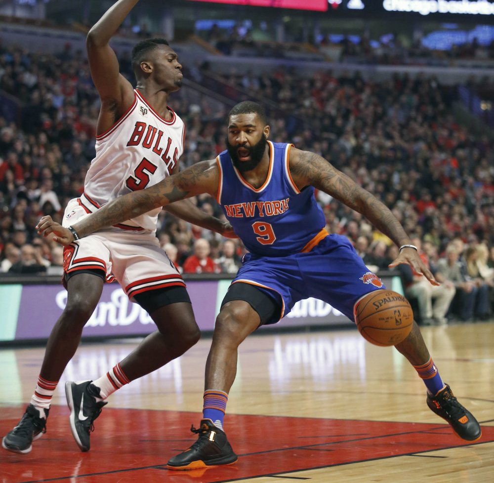 Chicago Bulls forward Bobby Portis guards New York Knicks forward Kyle O'Quinn during the first half of the Bulls' 108-81 win Friday in Chicago.