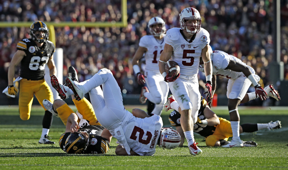Christian McCaffrey of Stanford heads to the end zone Friday against Iowa in the Rose Bowl. McCaffrey scored on a 75-yard pass on the first snap, then on a 66-yard punt return, and gained 368 all-purpose yards in a 45-16 victory.