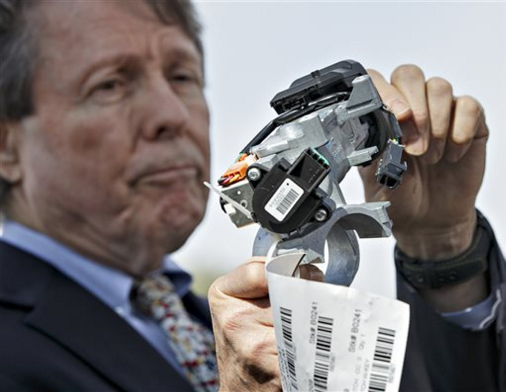 Clarence Ditlow, executive director of the Center for Auto Safety, displays a GM ignition switch similar to those linked to 13 deaths and dozens of crashes of General Motors small cars like the Chevy Cobalt, during an April 2014 news conference on Capitol Hill.