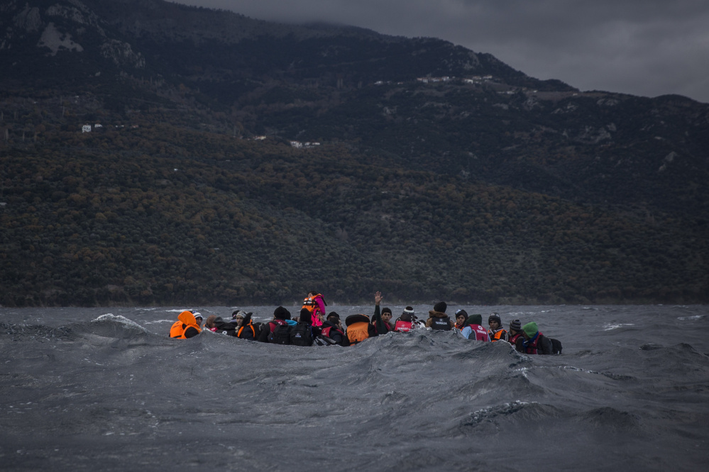 Refugees on a dinghy approach the Greek island of Lesbos. According to official estimates, about 1 million people fled to Europe last year.