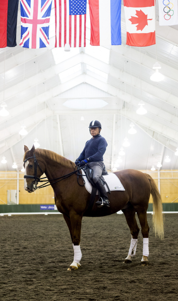 Michael Poulin, one of the country's foremost trainers and riders in dressage, works out with his horse Thor M at Pineland Farms Equestrian Center in New Gloucester.