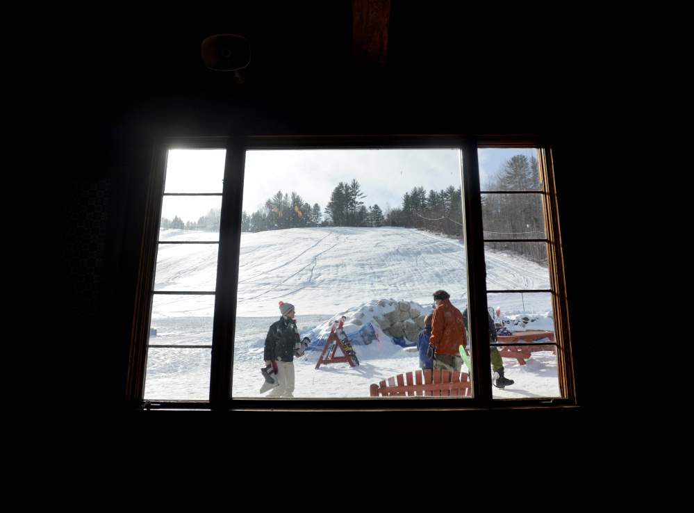 A winter wonderland is finally visible through a lodge window at Titcomb Mountain in West Farmington.