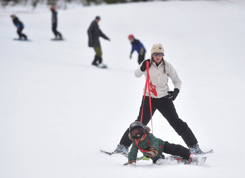 Jessica Eillingwood-Simpson teaches her son Wes, 4, how to ski Saturday at Titcomb Mountain in West Farmington.