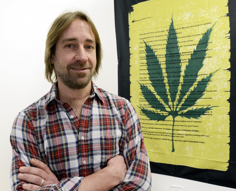 Dawson Julia, a medical marijuana caregiver in Unity, eschews using his own bank account for his growing business, which means having to pay his relatively high electric bills in cash.