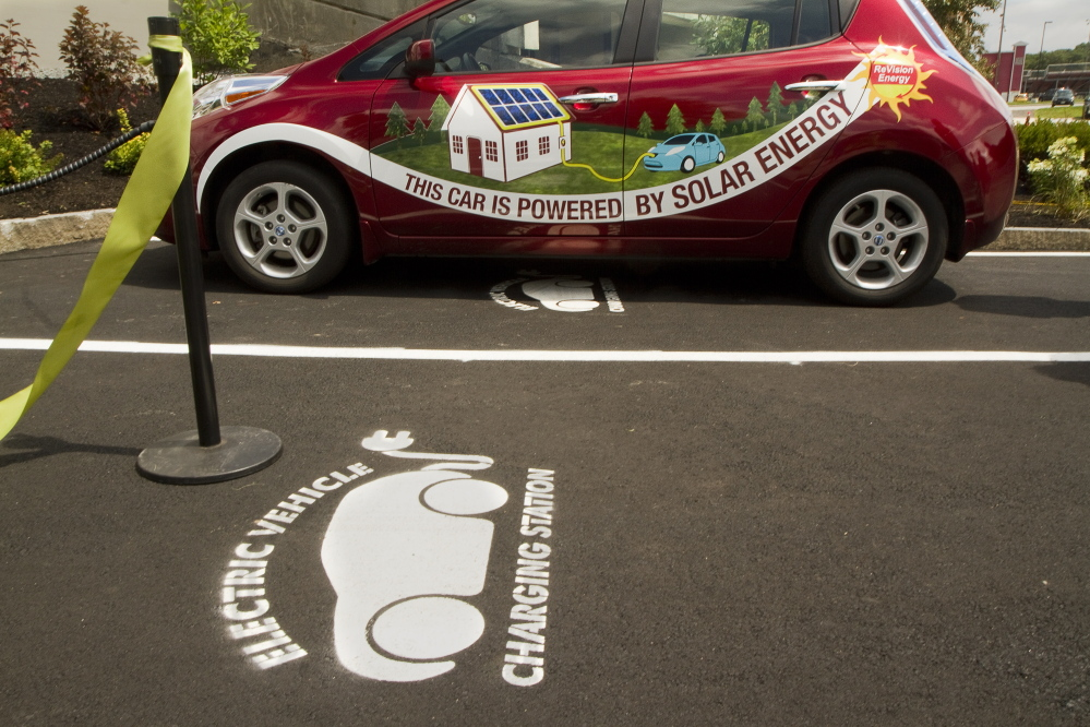 An electric car recharges at a DC Quick Charge station in South Portland. Taking issue with a subhead that an editor wrote for a recent op-ed, a reader says that people with ecological concerns are more patriotic than those who don't care about the environment.