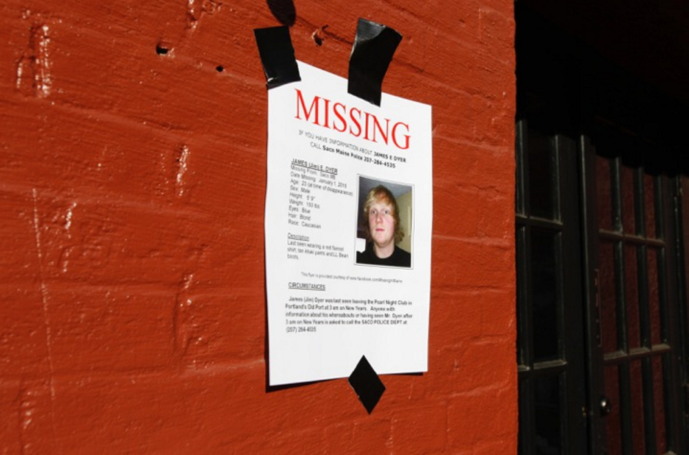 Posters are plastered on the walls of the Old Port in Portland, where James Dyer was last seen early New Year's Day.