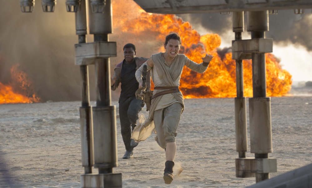 "Daisy Ridley and John Boyega are shown in a scene from ""Star Wars: The Force Awakens,"" directed by J.J. Abrams."