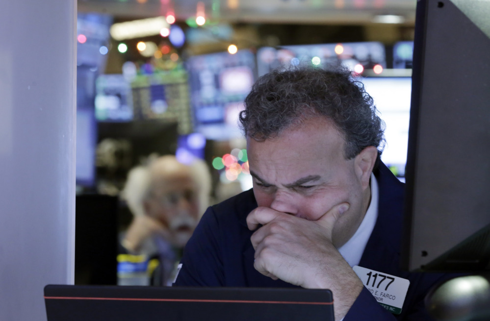 Gerard Farco works on the floor of the New York Stock Exchange on Monday, when the Dow Jones industrial average lost 276 points for the day.