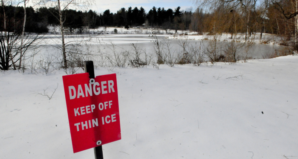A sign warns skaters to stay off the ice at Johnson Pond on the Colby College campus in Waterville on Monday.