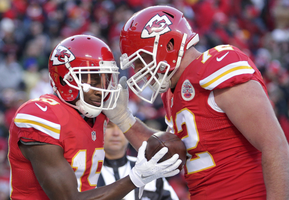 Wide receiver Jeremy Maclin, left, and offensive tackle Eric Fisher helped the Chiefs win 10 straight games after starting the season 1-5. Kansas City is a three-point favorite to beat Houston in their wild-card matchup.