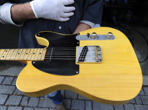 Richard Roth shows off a vintage Fender Telecaster. Gordon Chibroski/Staff Photographer)
