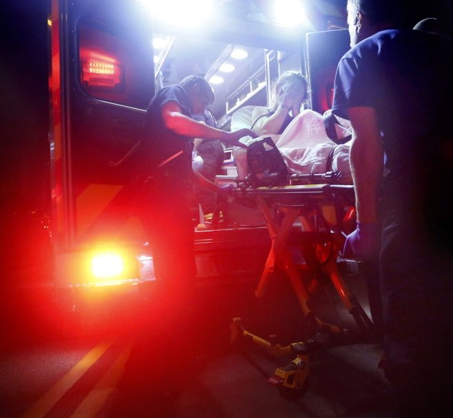 Portland paramedics load a woman into an ambulance . in 2015 after administering Narcan to revive her following a heroin overdose.