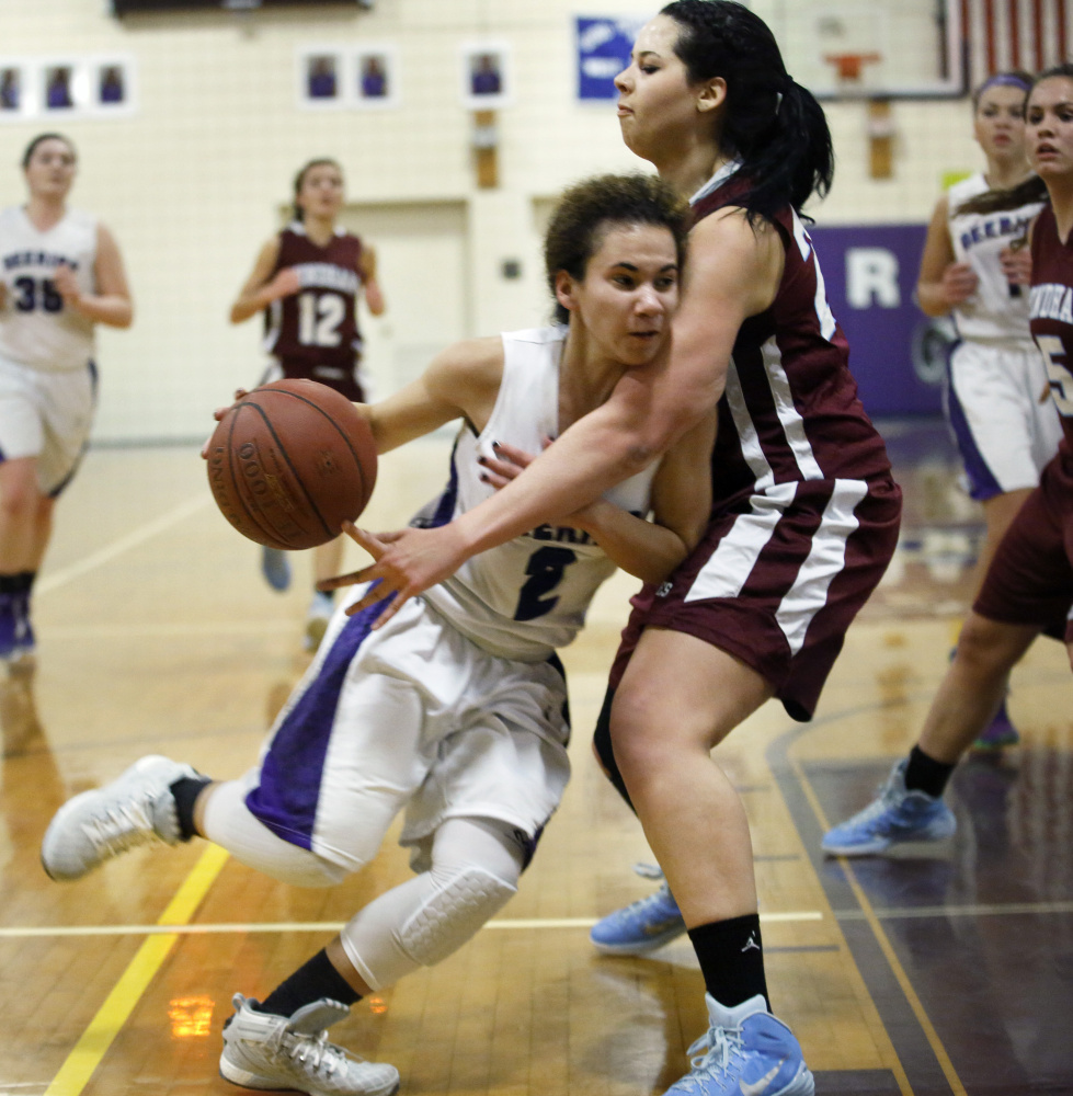 Abby Ramirez of Deering powers her way past Makayla Watson of Windham during their game Tuesday.