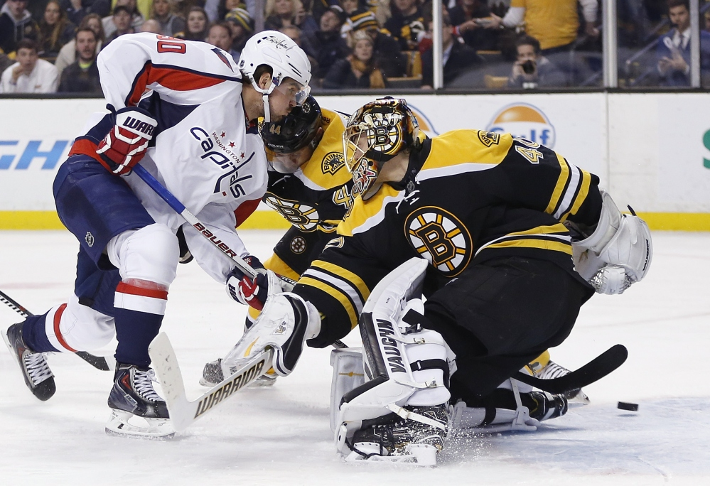 The Capitals' Marcus Johansson scores in the third period, when Washington took a two-goal lead that Boston couldn't overcome.