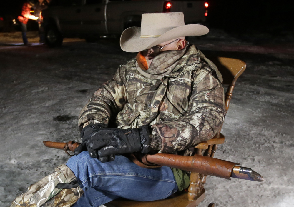 Arizona rancher LaVoy Finicum, holds as he guards the Malheur National Wildlife Refuge, Tuesday near Burns, Ore.