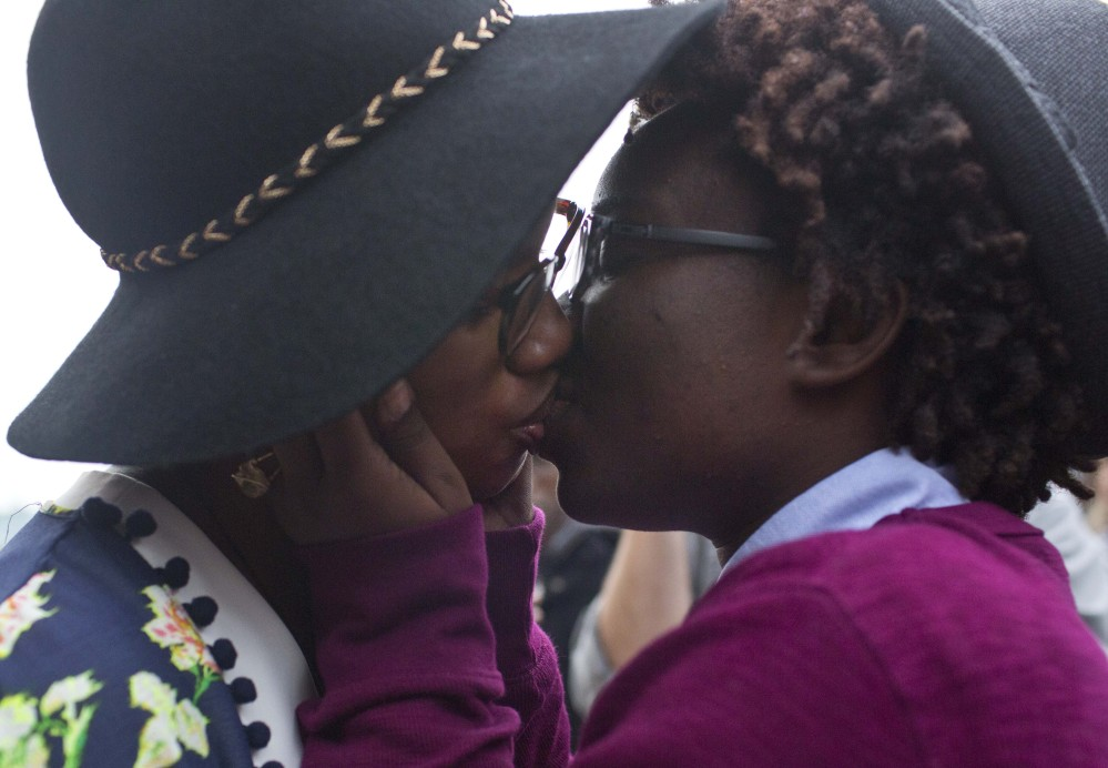 "Tori Sisson, left, and Shante Wolfe kiss after saying their marriage vows in Montgomery, Ala., last year. A University of Alabama law professor described the state chief justice's defiance of the U.S. Supreme Court ruling legalizing same-sex marriage as ""an exercise in futility."""