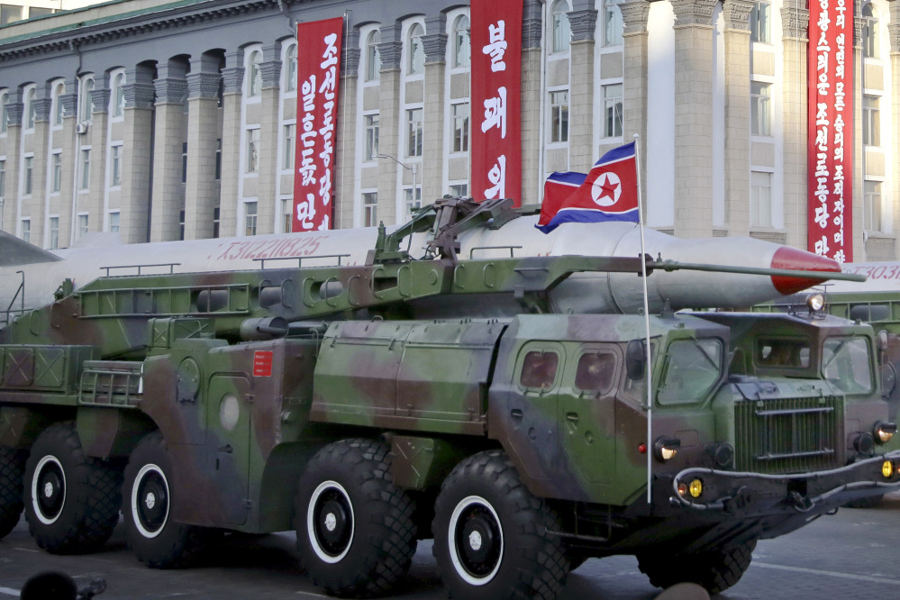 What is believed to be an improved version of the KN-08 ballistic missile is paraded in Pyongyang, North Korea, during the 70th anniversary celebrations of its ruling party's creation in September 2015.