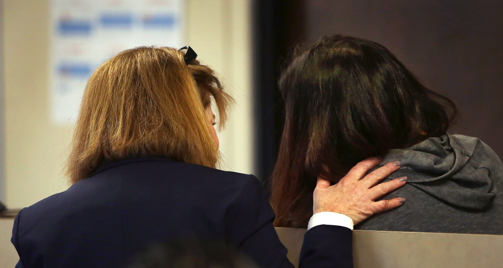 Rachelle Bond, right, consults with her defense attorney, Janice Bassil, as she is arraigned before Magistrate Edward J. Curley in Suffolk Superior Court in Boston on Wednesday.