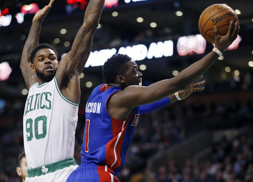 The Pistons' Reggie Jackson shoots in front of the Celtics' Amir Johnson on his way to a 24-point game.