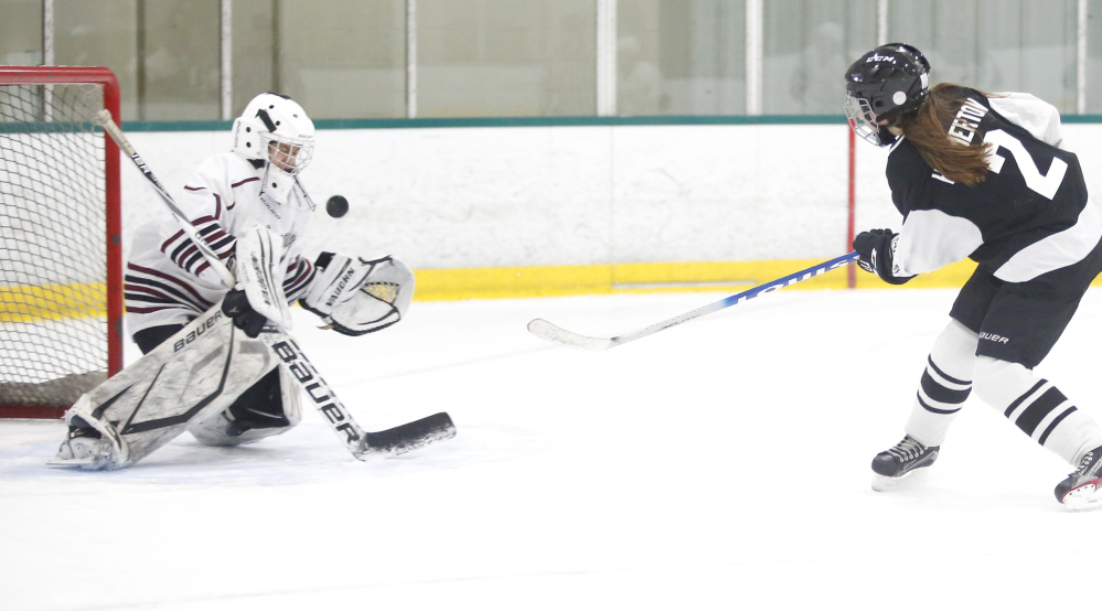 Nica Todd of Greely makes a save on a breakaway by Bugsy Hammerton in the second period. Todd made 25 saves as the Rangers handed the Saints their first loss in nine games.