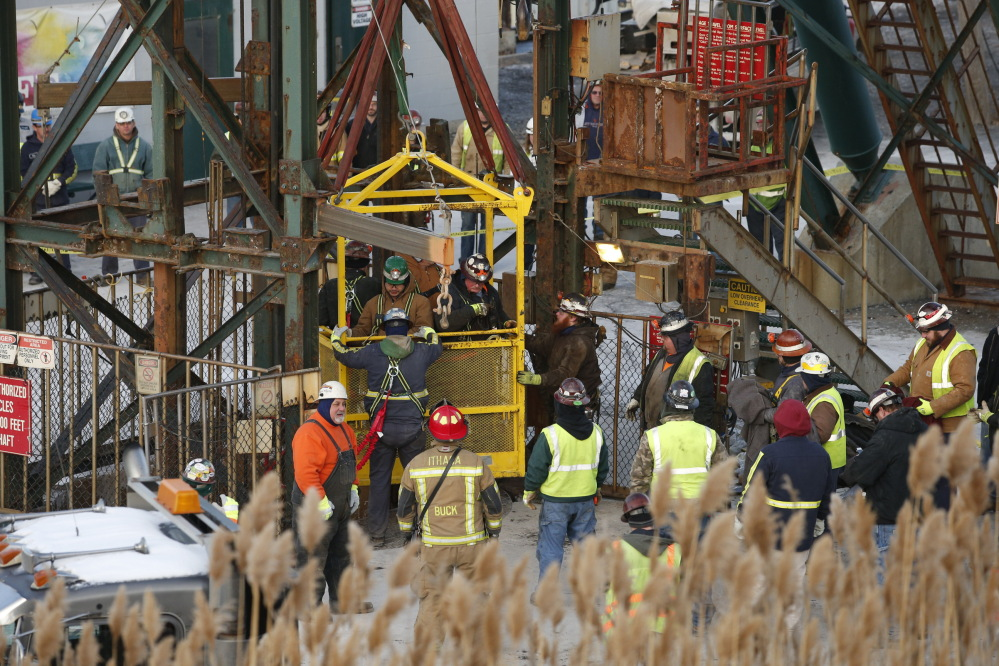 The fourth group of workers emerge from an elevator Thursday after being stuck overnight in a shaft at the Cayuga Salt Mine in Lansing, N.Y. Cargill Inc. spokesman Mark Klein said all 17 miners have been rescued.