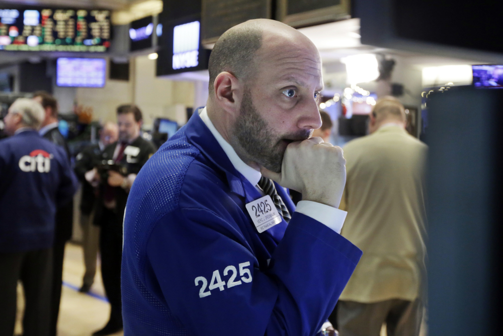 Specialist Meric Greenbaum works on the floor of the New York Stock Exchange on Thursday, as worries intensify about China's economy and dropping oil prices.