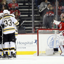 The Bruins celebrate a second-period goal by Jimmy Hayes on their way to a 4-1 win in New Jersey.