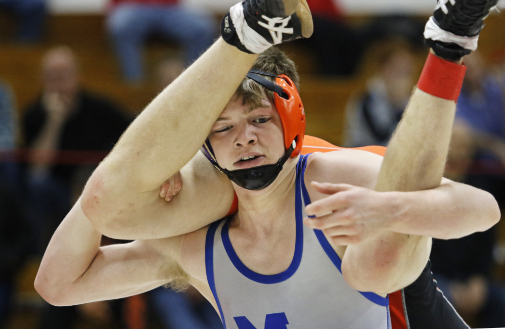 Ethan Boucher of Mountain Valley gives Dwayne Dyer of Biddeford a lift during the 138-pound consolation final Saturday at the Spartan Wrestling Tournament in Sanford. Boucher won the match, 12-0.