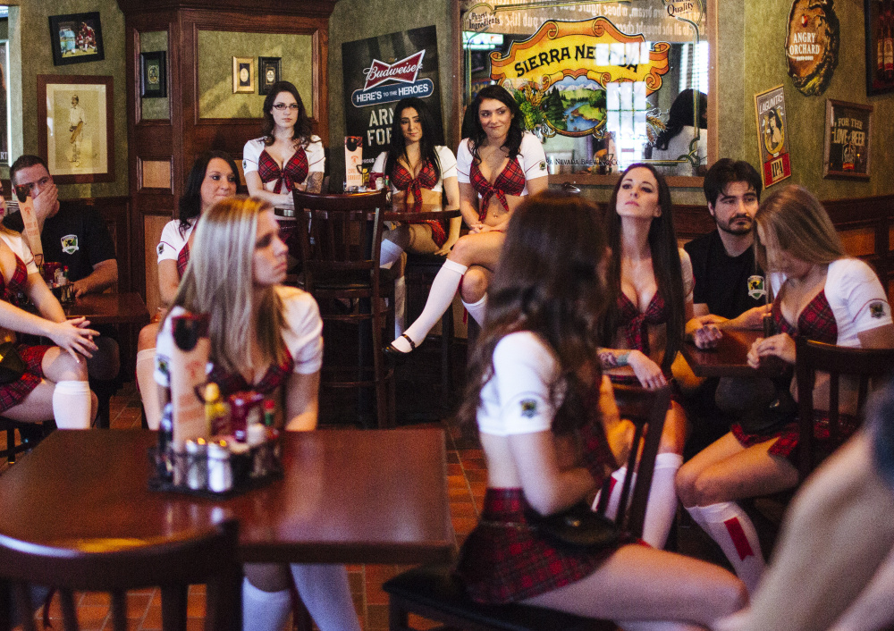 Tilted Kilt server/entertainers and bartenders listen Friday as their training manager lists the day's available drinks and specials in South Portland. The restaurant has seating for 225 patrons and will employ about 70 people.
