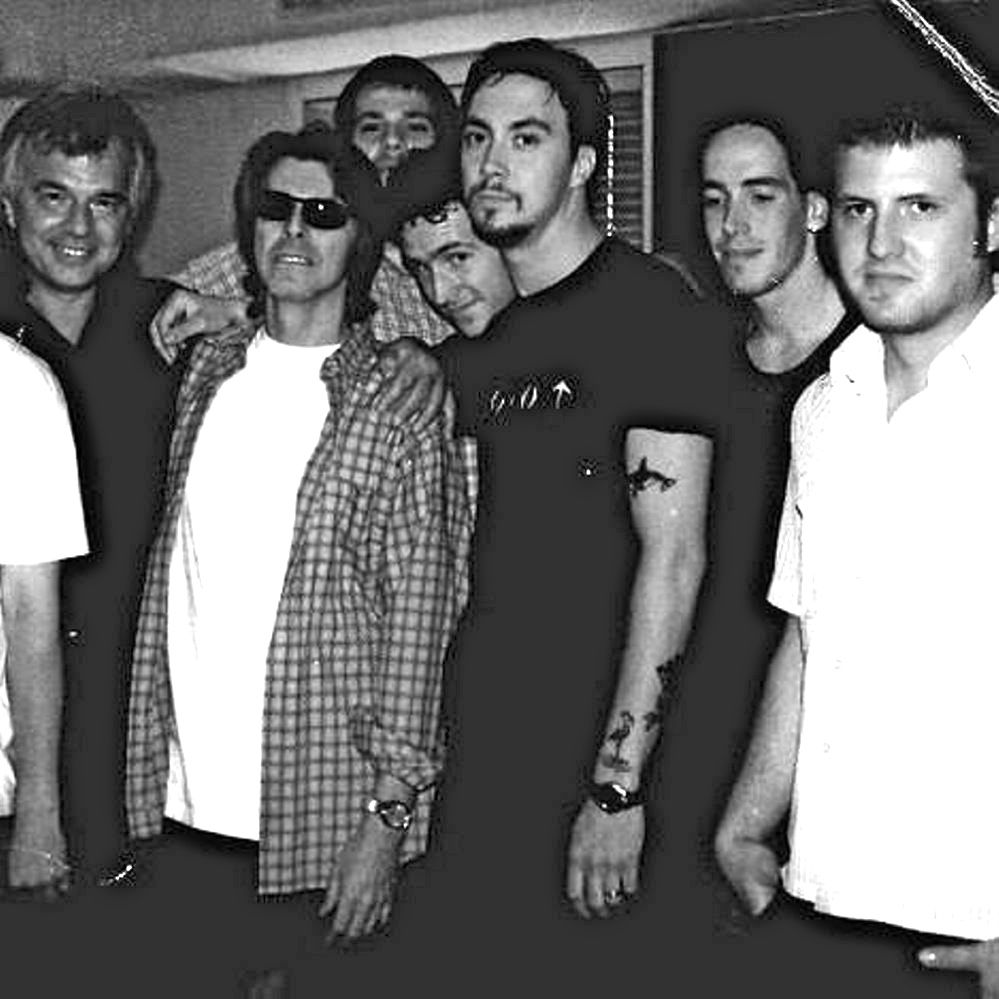 Dave Gutter, center, and other members of the Maine band Rustic Overtones stand with David Bowie, wearing sunglasses, during a Long Island recording session in 1999. Courtesy Dave Gutter
