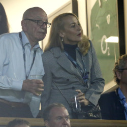 Media mogul Rupert Murdoch stands with model Jerry Hall during the Rugby World Cup final between New Zealand and Australia at Twickenham Stadium, London.