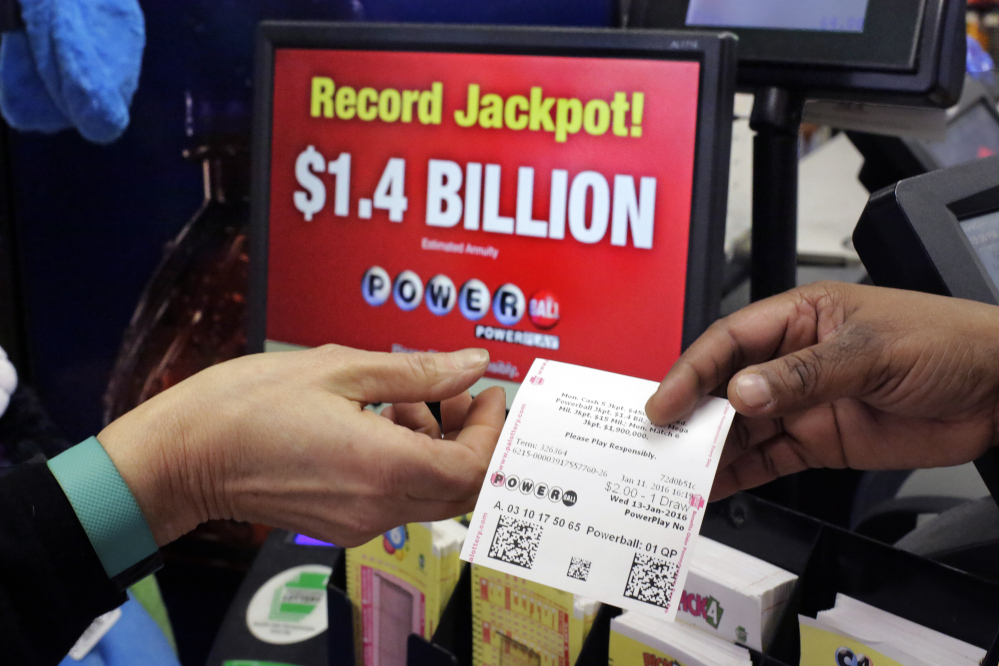 A Powerball ticket is sold in a truck stop in Carlisle, Pa., Monday, Jan. 11, 2016. The Powerball jackpot has grown to over 1 billion dollars.