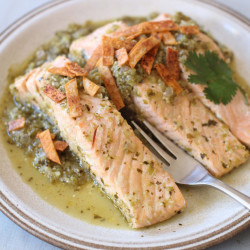 Salmon poached in green salsa and topped with baked chips. This dish is delicious cold or hot.
