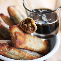 Baked egg rolls with sesame-soy dipping sauce. (AP Photo/Matthew Mead)