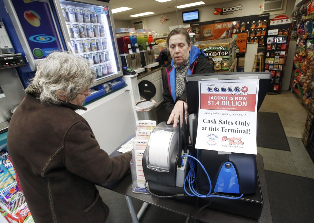 Owner Rose West sells Powerball tickets to Jan Corey of South Portland at Broadway Variety in South Portland on Tuesday. The store received a secondary terminal which will come in handy if business gets as busy as it did last weekend, when the line stretched out the door with customers waiting to purchase tickets.