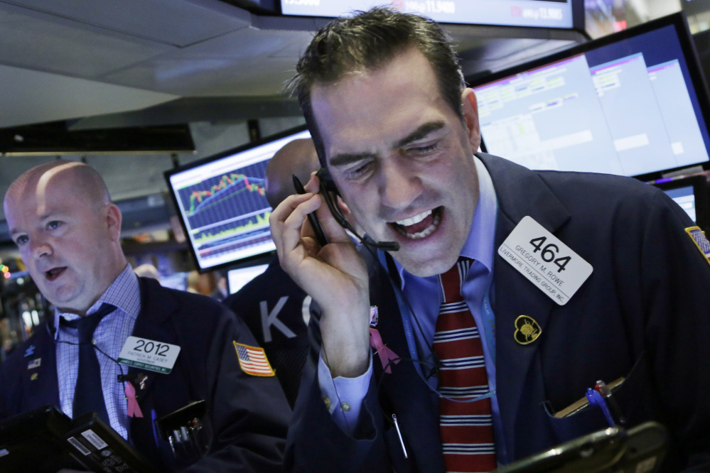 Stock trader Gregory Rowe works at the New York Stock Exchange on Friday.