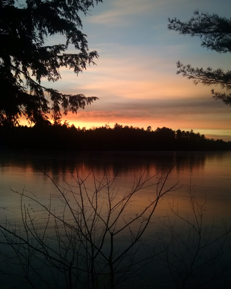 The dawning of another day on  Forest Lake, where Paula Curcio of Gray was up to greet the sun.