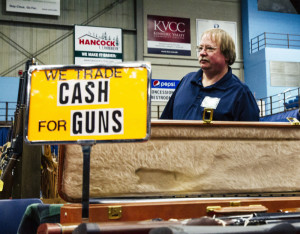 Craig Taylor of South China stands at his table at the gun show at the Augusta Civic Center on Saturday. Whitney Hayward/Staff Photographer